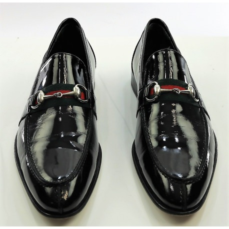 Gucci's Black patent shoes